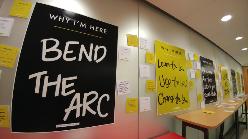 signs on the wall at CUNY Law School about 'Why I'm Here': 'Bend The Arc', 'Learn The Law, Use The Law, Change The Law'