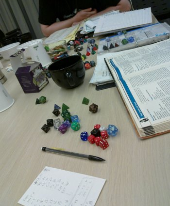 dice, books, and mug