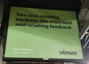 Billboard-style ad for Vimeo: 'Turn soul-crushing feedback into organized soul-crushing feedback.'